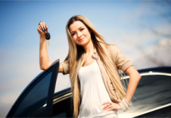 lady holding a car key